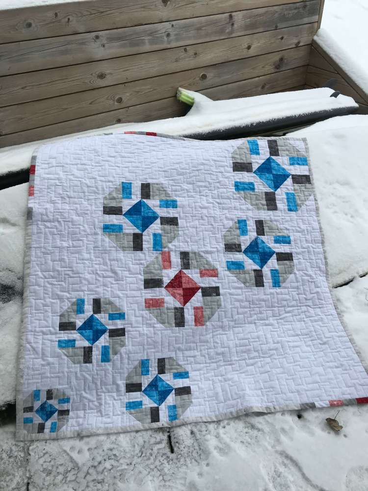 a blue quilt with sparkle pattern 1 by Stich and a Round